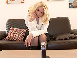 Blonde housewife masturbating on the couch