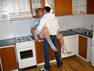 Horny housewife fucking in her kitchen